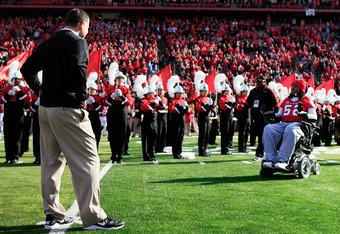 NEW BRUNSWICK, NJ - NOVEMBER 19:  Eric LeGrand #52 of the Rutgers Scarlet Knights enters the stadium to be honored on Senior's Day at center field with head coach Greg Schiano of the Rutgers Scarlet Knights before a game against Cincinnati Bearcats at Rut