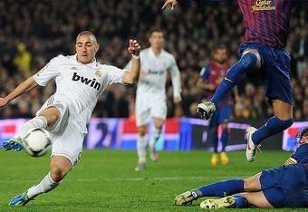 Benzema fools Puyol and scores
