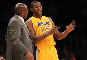 LOS ANGELES, CA - DECEMBER 27:  Metta World Peace #15  and Head coach Mike Brown of the Los Angeles Lakers talk during the game with the Utah Jazz at Staples Center on December 27, 2011 in Los Angeles, California.  The Lakers won 96-71.  NOTE TO USER: Use