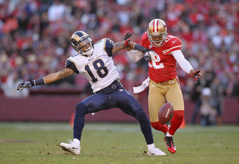 SAN FRANCISCO, CA - DECEMBER 04:  Carlos Rogers #22 of the San Francisco 49ers breaks up a pass intended for Austin Pettis #18 of the St. Louis Rams at Candlestick Park on December 4, 2011 in San Francisco, California.  (Photo by Ezra Shaw/Getty Images)