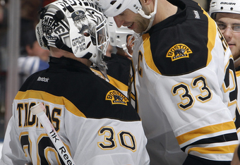 Boston's Captain Zdeno Chara celebrating with his goaltender Tim Thomas