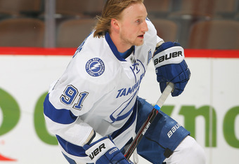 DENVER, CO - DECEMBER 23:  Steven Stamkos #91 of the Tampa Bay Lightning warms up prior to facing the Colorado Avalanche at the Pepsi Center on December 23, 2011 in Denver, Colorado. The Avalanche defeated the Lightning 2-1 in overtime.  (Photo by Doug Pe