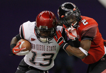 NEW ORLEANS, LA - DECEMBER 17:  Ronnie Hillman #13 of the San Diego State Aztecs is pushed out of bounds by Jemarlous Moten #2 of the Louisiana-Lafayette Ragin Cajuns during the R&L Carriers New Orleans Bow at the Mercedes-Benz Superdome on December 17, 2