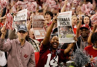 NEW ORLEANS, LA - JANUARY 09:  Fans of the Alabama Crimson Tide celebrate after defeating Louisiana State University Tigers in the 2012 Allstate BCS National Championship Game at Mercedes-Benz Superdome on January 9, 2012 in New Orleans, Louisiana. Alabam