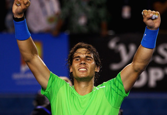 MELBOURNE, AUSTRALIA - JANUARY 26:  Rafael Nadal of Spain celebrates winning his semifinal match against Roger Federer of Switzerland during day eleven of the 2012 Australian Open at Melbourne Park on January 26, 2012 in Melbourne, Australia.  (Photo by C