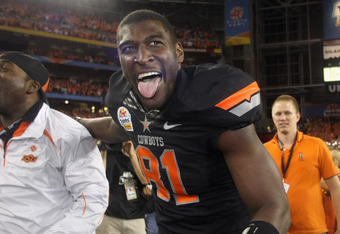 GLENDALE, AZ - JANUARY 02:  Justin Blackmon #81 of the Oklahoma State Cowboys celebrates after Oklahoma State Cowboys won 41-38 in overtime against the Stanford Cardinal during the Tostitos Fiesta Bowl on January 2, 2012 at University of Phoenix Stadium i