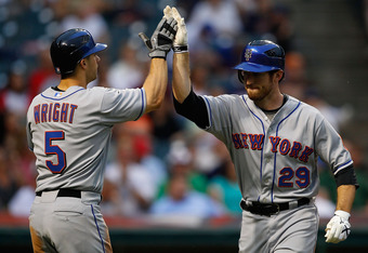 CLEVELAND - JUNE 15:  David Wright #5 of the New York Mets congratulates teammate Ike Davis #29 after he hit a two run home run against the Cleveland Indians during the game on June 15, 2010 at Progressive Field in Cleveland, Ohio.  (Photo by Jared Wicker