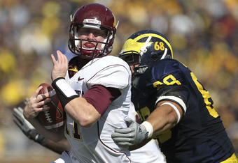ANN ARBOR, MI - OCTOBER 01: Mike Martin #68 of the Michigan Wolverines sacks Max Shortell #11 of the Minnesota Golden Gophers during the second quarter of the game at Michigan Stadium on October 1, 2011 in Ann Arbor, Michigan.  (Photo by Leon Halip/Getty