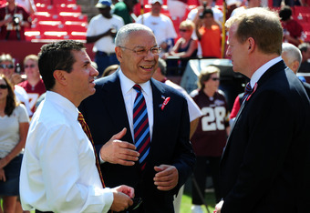 LANDOVER, MD - SEPTEMBER 11: Washington Redskins Owner Daniel Snyder (L) chats with former United States Secretary Of State Colin Powell (C) and NFL Commissioner Roger Goodell before the season-opening game against the New York Giants at FedEx Field on Se