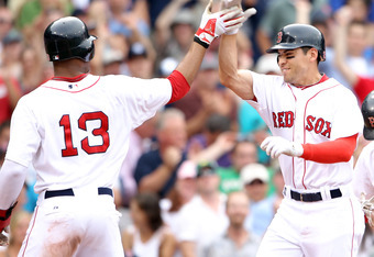 BOSTON, MA - AUGUST 06:  Jacoby Ellsbury #2 of the Boston Red Sox is congratulated by teammate Carl Crawford after Ellsbury hit a 3 run homer in the fourth inning against the New York Yankees on August 6, 2011 at Fenway Park in Boston, Massachusetts.  (Ph