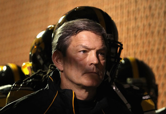 TEMPE, AZ - DECEMBER 28:  Head coach Kirk Ferentz of the Iowa Hawkeyes stands in the tunnel before the Insight Bowl against the Missouri Tigers at Sun Devil Stadium on December 28, 2010 in Tempe, Arizona.  The Hawkeyes defeated the Tigers 27-24.  (Photo b