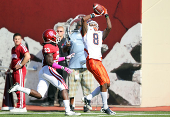 BLOOMINGTON, IN - OCTOBER 08:  A.J. Jenkins #8 of the Illinois Illini catches a pass while defended by Lawrence Barnett #23 of the Indiana Hoosiers during the game at Memorial Stadium on October 8, 2011 in Bloomington, Indiana.  Illinois won 41-20.  (Phot