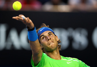 MELBOURNE, AUSTRALIA - JANUARY 26:  Rafael Nadal of Spain serves in his semifinal match against Roger Federer of Switzerland during day eleven of the 2012 Australian Open at Melbourne Park on January 26, 2012 in Melbourne, Australia.  (Photo by Clive Brun