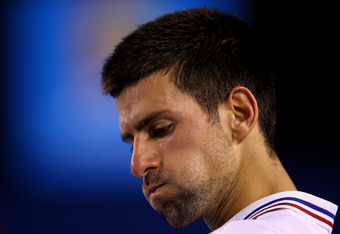 MELBOURNE, AUSTRALIA - JANUARY 27:  Novak Djokovic of Serbia rests during a break in his semifinal match against Andy Murray of Great Britain during day twelve of the 2012 Australian Open at Melbourne Park on January 27, 2012 in Melbourne, Australia.  (Ph