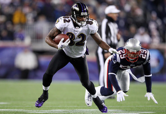 FOXBORO, MA - JANUARY 22:  Torrey Smith #82 of the Baltimore Ravens breaks a tackle by  Sterling Moore #29 of the New England Patriots to score a touchdown in the third quarter during their AFC Championship Game at Gillette Stadium on January 22, 2012 in