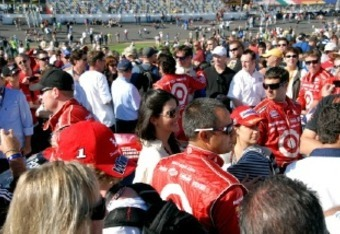 Crowds swarm Juan Pablo Montoya on pit road in Daytona before the start of the Rolex 24