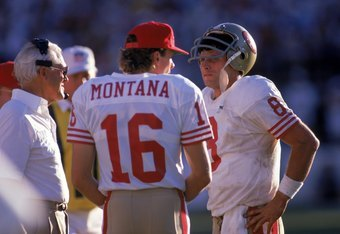 TEMPE, AZ - NOVEMBER 6:  Quarterbacks Steve Young #8 and Joe Montana #16 of the San Francisco 49ers discuss strategy with head coach Bill Walsh during the game against the Phoenix Cardinals at Sun Devil Stadium on Novemer 6, 1988 in Tempe, Arizona.  The C