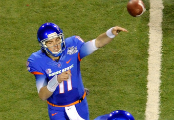 LAS VEGAS, NV - DECEMBER 22:  Quarterback Kellen Moore #11 of the Boise State Broncos throws against the Arizona State Sun Devils after faking a handoff to Doug Martin #22 during the MAACO Bowl Las Vegas at Sam Boyd Stadium December 22, 2011 in Las Vegas,