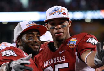 ARLINGTON, TX - JANUARY 06:  (L-R) Joe Adams #3 and Greg Childs #85 of the Arkansas Razorbacks celebrate a win against the Kansas State Wildcats during the Cotton Bowl at Cowboys Stadium on January 6, 2012 in Arlington, Texas.  (Photo by Ronald Martinez/G