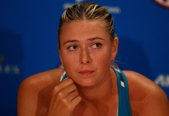 MELBOURNE, AUSTRALIA - JANUARY 28:  Maria Sharapova of Russia speaks in a press conference after losing her women's final match against Victoria Azarenka of Belarus during day thirteen of the 2012 Australian Open at Melbourne Park on January 28, 2012 in M