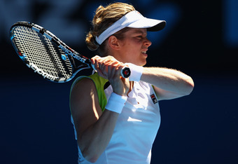 MELBOURNE, AUSTRALIA - JANUARY 26:  Kim Clijsters of Belgium plays a backhand in her semifinal match against Victoria Azarenka of Belarus during day eleven of the 2012 Australian Open at Melbourne Park on January 26, 2012 in Melbourne, Australia.  (Photo