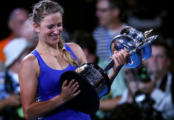 MELBOURNE, AUSTRALIA - JANUARY 28:  Victoria Azarenka of Belarus poses with the Daphne Akhurst Memorial Cup after winning her women's final match against Maria Sharapova of Russia, and being named world number one, during day thirteen of the 2012 Australi