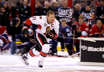 OTTAWA, ON - JANUARY 28:  Daniel Alfredsson #11 of the Ottawa Senators and team Alfredsson competes in the Blackberry NHL Hardest Shot portion of the 2012 Molson Canadian NHL All-Star Skills Competition at Scotiabank Place on January 28, 2012 in Ottawa, O