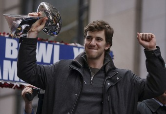NEW YORK - FEBRUARY 05:  New York Giants quarterback Eli Manning holds up the Vince Lombardi trophy during the New York Giants Superbowl XLII victory parade February 5, 2008 in New York City.  (Photo by Chris McGrath/Getty Images)