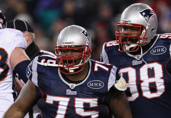 FOXBORO, MA - JANUARY 14:  Vince Wilfork #75 and Gerard Warren #98 of the New England Patriots react against the Denver Broncos during their AFC Divisional Playoff Game at Gillette Stadium on January 14, 2012 in Foxboro, Massachusetts.  (Photo by Elsa/Get