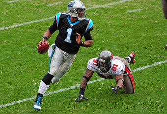 CHARLOTTE, NC - DECEMBER 24: Cam Newton #1 of the Carolina Panthers scrambles against the Tampa Bay Buccaneers at Bank of America Stadium on December 24, 2011 in Charlotte, North Carolina  (Photo by Scott Cunningham/Getty Images)