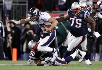 FOXBORO, MA - JANUARY 14:  Tim Tebow #15 of the Denver Broncos is pressured by Rob Ninkovich #50 and Vince Wilfork #75 of the New England Patriots during their AFC Divisional Playoff Game at Gillette Stadium on January 14, 2012 in Foxboro, Massachusetts.
