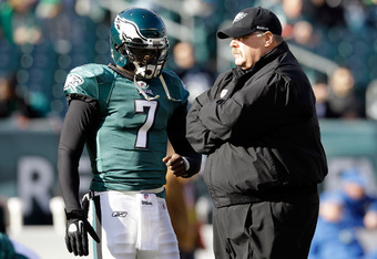 PHILADELPHIA, PA - JANUARY 01:  Michael Vick #7 of the Philadelphia Eagles talks with head coach Andy Reid before the start of the Eagles game against the Washington Redskins at Lincoln Financial Field on January 1, 2012 in Philadelphia, Pennsylvania.  (P