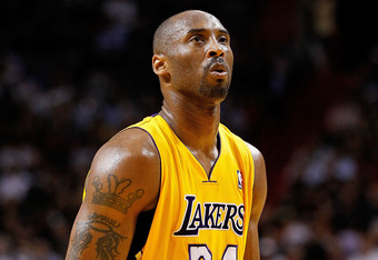 MIAMI, FL - JANUARY 19:  Kobe Bryant #24 of the Los Angeles Lakers lshoots a free throw during a game against the Miami Heat at American Airlines Arena on January 19, 2012 in Miami, Florida. NOTE TO USER: User expressly acknowledges and agrees that, by do