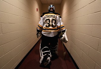 GLENDALE, AZ - DECEMBER 28:  Goaltender Tim Thomas #30 of the Boston Bruins walks back to the locker room before the NHL game against the Phoenix Coyotes at Jobing.com Arena on December 28, 2011 in Glendale, Arizona.  (Photo by Christian Petersen/Getty Im