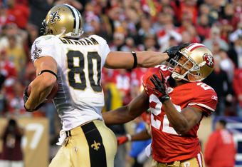 SAN FRANCISCO, CA - JANUARY 14:  Jimmy Graham #80 of New Orleans Saints pushes away from Carlos Rogers #22 of the San Francisco 49ers and goes 66 yards for a touchdown in the fourth quarter during the NFC Divisional playoff game at Candlestick Park on Jan