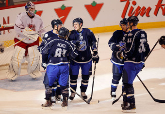 OTTAWA, ON - JANUARY 29:  Joffrey Lupul #19 of the Toronto Maple Leafs celebrates with his teammates after scoring a goal in the third period against Brian Elliott #1 of the St. Louis Blues  during the 2012 Tim Hortons NHL All-Star Game at Scotiabank Plac