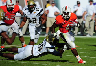 MIAMI GARDENS, FL - OCTOBER 22: Lamar Miller #6 of the Miami Hurricanes carries the ball against Euclid Cummings #99 of the Georgia Tech Yellow Jackets at Sun Life Stadium on October 22, 2011 in Miami Gardens, Florida. Photo by Scott Cunningham/Getty Imag