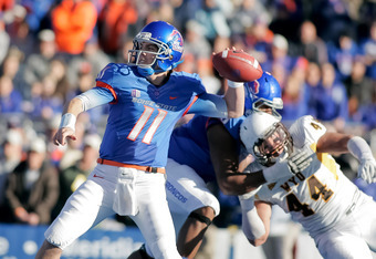 BOISE, ID - NOVEMBER 26:  Kellen Moore #11 of the Boise State Broncos passes against the Wyoming Cowboys at Bronco Stadium on November 26, 2011 in Boise, Idaho.  (Photo by Otto Kitsinger III/Getty Images)