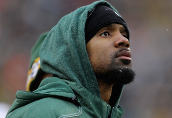 GREEN BAY, WI - JANUARY 01: Charles Woodson #21 of the Green Bay Packers, who did not dress for a game against the Detroit Lions, watches from the sidelines at Lambeau Field on January 1, 2012 in Green Bay, Wisconsin. The Packers defeated the Lions 45-41.
