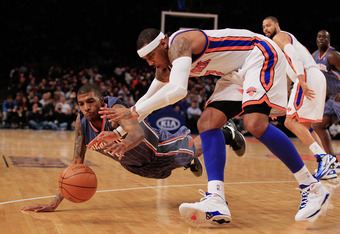 NEW YORK, NY - JANUARY 09: Carmelo Anthony #7 of the New York Knicks competes for a loose ball with Tyrus Thomas #12 of the Charlotte Bobcats at Madison Square Garden on January 9, 2012 in New York City. NOTE TO USER: User expressly acknowledges and agree