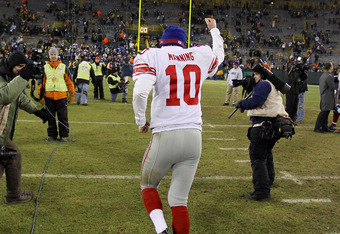 GREEN BAY, WI - JANUARY 15:   Eli Manning #10 of the New York Giants reacts after defeating the Green Bay Packers to win their NFC Divisional playoff game at Lambeau Field on January 15, 2012 in Green Bay, Wisconsin.  (Photo by Jonathan Daniel/Getty Image