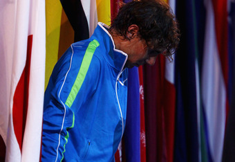 MELBOURNE, AUSTRALIA - JANUARY 29:  Rafael Nadal of Spain reacts after losing his men's final match against Novak Djokovic of Serbia during day fourteen of the 2012 Australian Open at Melbourne Park on January 29, 2012 in Melbourne, Australia.  (Photo by