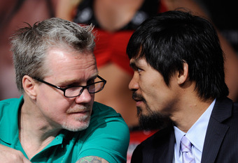 LAS VEGAS, NV - MAY 04:  Trainer Freddie Roach (L) talks with boxer Manny Pacquiao during the final news conference for Pacquiao's bout against Shane Mosley at the MGM Grand Hotel/Casino May 4, 2011 in Las Vegas, Nevada. Pacquiao will defend his WBO welte
