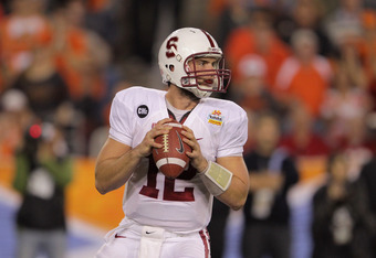 GLENDALE, AZ - JANUARY 02:  Andrew Luck #12 of the Stanford Cardinal looks to pass against the Oklahoma State Cowboys during the Tostitos Fiesta Bowl on January 2, 2012 at University of Phoenix Stadium in Glendale, Arizona. Oklahoma State won 41-38 in ove
