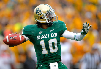 WACO, TX - DECEMBER 03:  Robert Griffin III #10 of the Baylor Bears looks to pass during a game against the Texas Longhorns at Floyd Casey Stadium on December 3, 2011 in Waco, Texas.  (Photo by Sarah Glenn/Getty Images)
