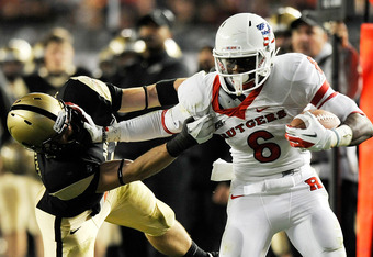 NEW YORK, NY - NOVEMBER 12:  Thomas Holloway #23 of the Army Black Knights tackles Mohamed Sanu #6 of the Rutgers Scarlet Knights during a game at Yankee Stadium on November 12, 2011 in the Bronx borough of New York City.  (Photo by Patrick McDermott/Gett