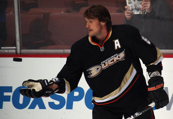 ANAHEIM, CA - JANUARY 10: Teemu Selanne #8 of the Anaheim Ducks throws a puck to fans during  warmups prior to the game against the Dallas Stars at the Honda Center on January 10, 2012 in Anaheim, California. The Ducks defeated the Stars 5-2.  (Photo by B