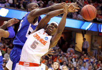 CLEVELAND, OH - MARCH 18: C.J. Fair #5 of the Syracuse Orange and Carl Richard #15 of the Indiana State Sycamores fight for a loose ball during the second round of the 2011 NCAA men's basketball tournament at Quicken Loans Arena on March 18, 2011 in Cleve