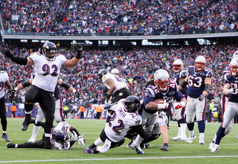 FOXBORO, MA - JANUARY 22:  BenJarvus Green-Ellis #42 of the New England Patriots runs the ball in for a touchdown in the second quarter against Jimmy Smith #22 of the Baltimore Ravens during their AFC Championship Game at Gillette Stadium on January 22, 2