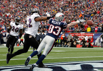 FOXBORO, MA - JANUARY 22:  Wes Welker #83 of the New England Patriots misses a catch as Ray Lewis #52 of the Baltimore Ravens defends him during their AFC Championship Game at Gillette Stadium on January 22, 2012 in Foxboro, Massachusetts.  (Photo by Rob